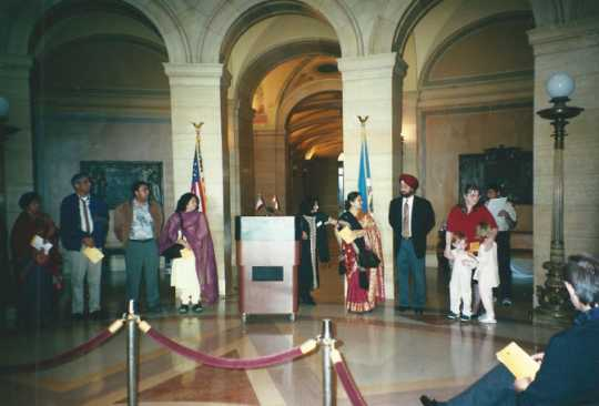Color image of an interfaith Prayer held in St. Paul on September 11, 2002, at the State Capitol by the India Association of Minnesota to commemorate the terrorist attacks of September 11, 2001.