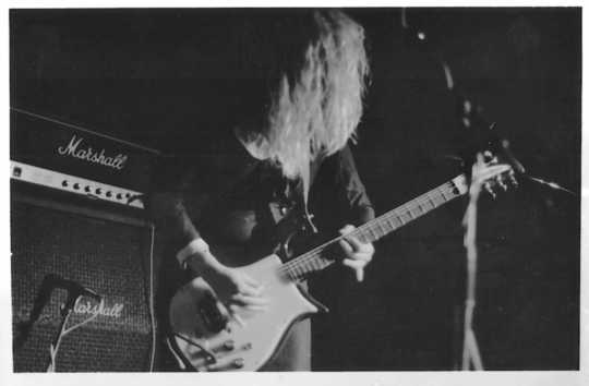 Black and white photograph of Kat Bjelland performing with Babes in Toyland in Paris, 1991.