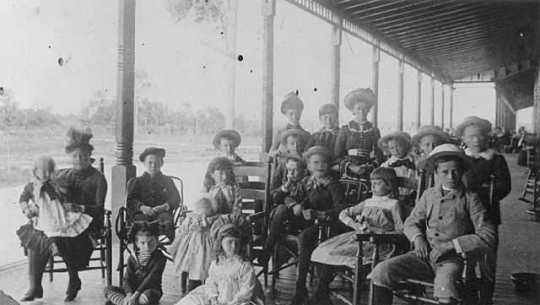 Black-and-white photograph of children on the porch of the Lafayette Hotel, c.1890.