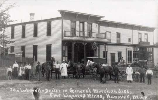 Black and white photograph of John Lockedell General Merchandise & Fine Liquors, ca. 1900–1910.