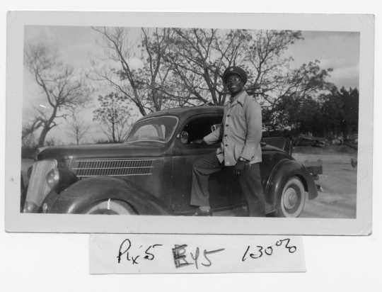 Oscar C. Howard with his first car, purchased in the 1940s while he was in college. It later served as the delivery vehicle for his catering business in Minneapolis. From the Oscar C. Howard papers (P1842), Manuscripts Collection, Minnesota Historical Society.