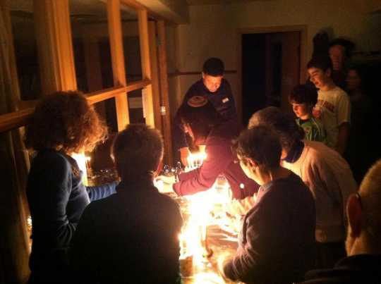 Color image of Mayim Rabim Congregation members gathered to celebrate Chanukah, 2013.
