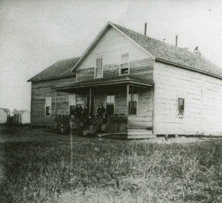 Black and white photograph of the first school at St. Mary's Mission, Red Lake, Minnesota, c.1880s.