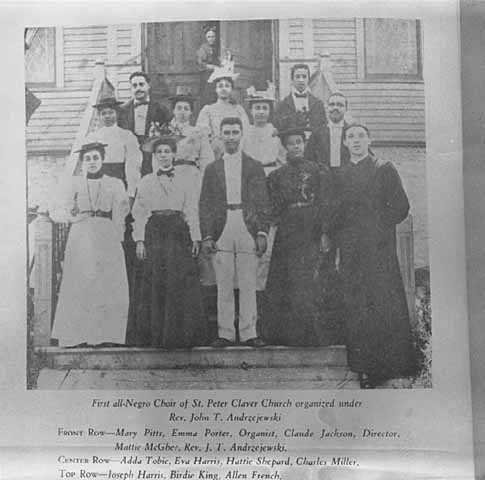 Photograph of church choir members on the steps of St. Peter Claver.