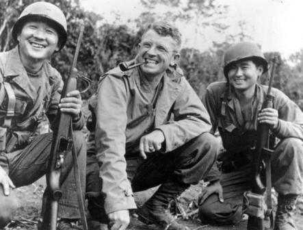 Black and white photograph of General Frank Merrill with Nisei interpreters, c.1945.