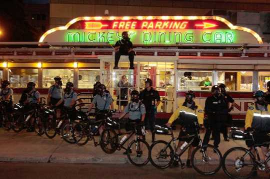 Police put up a barricade in front of Mickey's Diner during a protest at the Republican National Convention in September 2008. Photograph taken for MinnPost by Terry Gydesen.