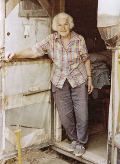 Color image of Dorothy Molter at the door of her summer tent on Knife Lake, ca. 1985.