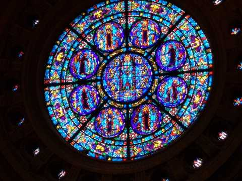 Color image of a north-facing, stained-glass rose window of the St. Paul Cathedral. Photographed by Paul Nelson on July 10, 2014.