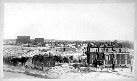View of Lowry District of Minneapolis; Thomas Lowry residence in foreground at H
