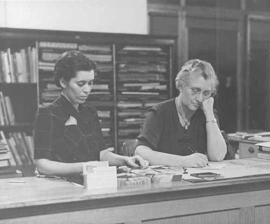 Gratia A. Countryman at desk in Minneapolis Public Library