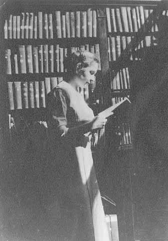 Gratia Countryman, librarian, in library stacks