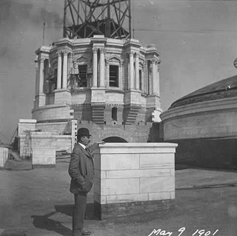 Cass Gilbert standing before partial State Capitol dome