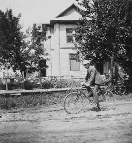 Theodore Palmer on a bicycle