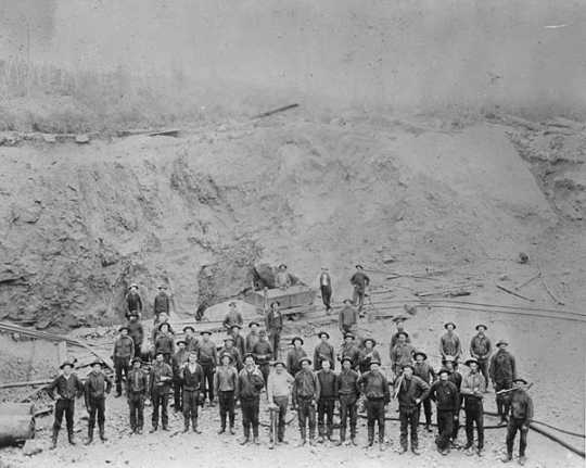Miners and car in the pit, Tower-Soudan Mine