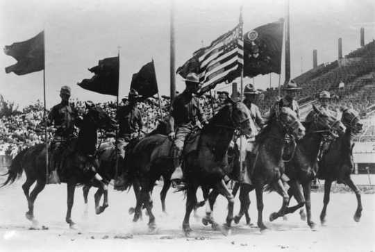 Color bearers of the 151st Field Artillery on parade