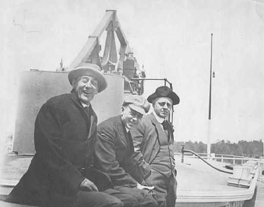 Governor John A. Johnson with two unidentified men