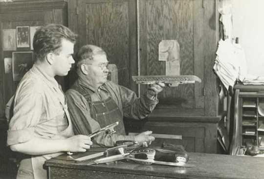 John E. Strauss Jr. and Sr. in skate shop