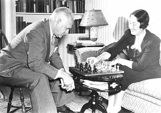Black and white photograph of Maud Hart Lovelace and husband Delos playing chess, c.1945.