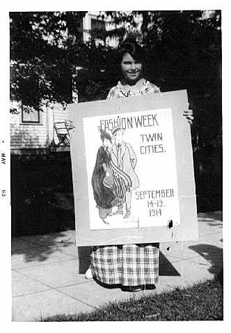 Photograph of Wanda Gág with a poster she submitted in a contest, 1914.