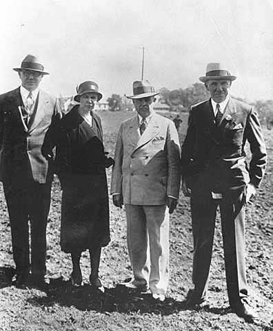 Myrtle Cain with O. W. Behrues, Mike E. Collins, and Floyd B. Olson