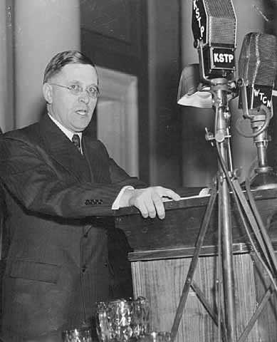 Black and white photograph of Elmer Benson giving a speech, c.1937.