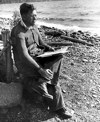 Black and white photograph of Elmer Benson by a lake, 1937.
