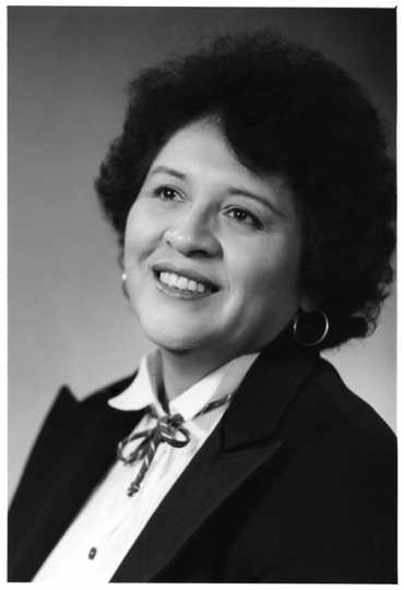 Irene Gomez of the Police and Community Relations Task Force. Photograph by Erickson Studio, ca. 1983.