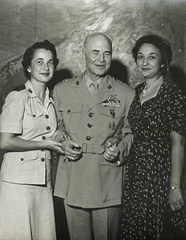 Black and white photograph of Melvin J. Maas with daughter Patricia and wife Katherine, 1952.