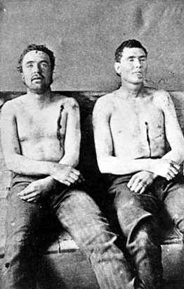 Black and white photograph of Clell Miller and Bill Chadwell (misidentified by authorities as Bill Stiles) both deceased, September 7, 1876.
