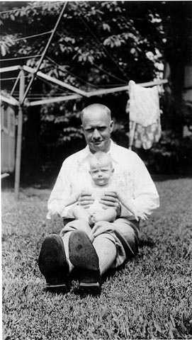 Black and white photograph of Delos Lovelace with his daughter, Merion, c.1931.