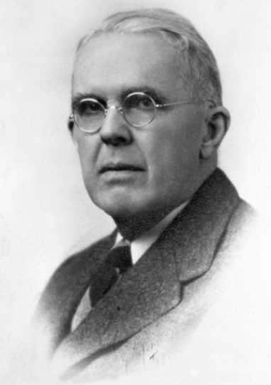 Black and white photograph of Robbins Gilman, c.1950.