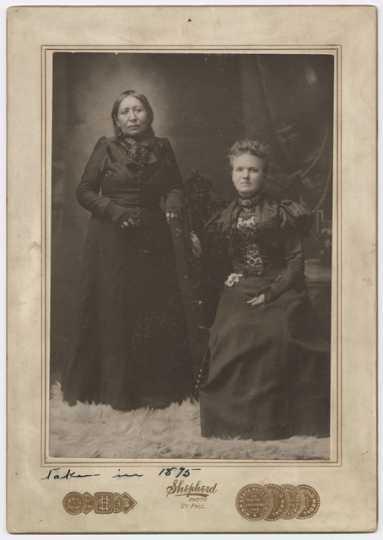 Mary E. Schwandt Schmidt (Mrs. William) and Snana Good Thunder (Maggie Brass), 1899. Photo by Shepherd Photo Studio.