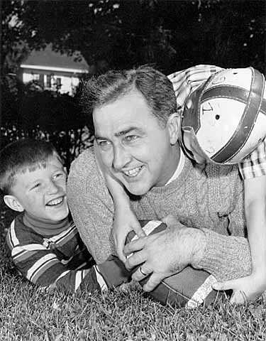 Black and white photograph of Eugene McCarthy with son Michael and unknown boy, c.1959.