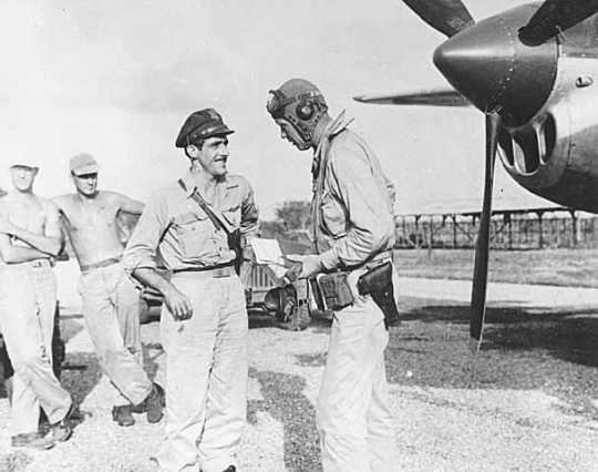 Black and white photograph of Charles Augustus Lindbergh with Tommy McGuire in the South Pacific, 1944.