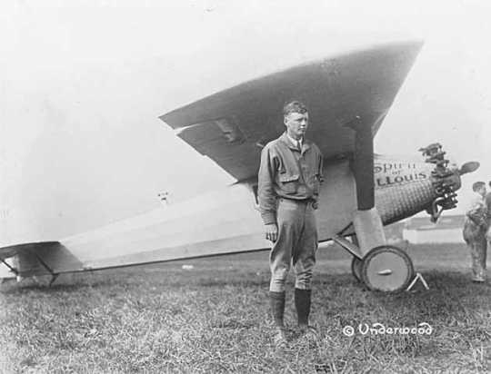 """Black and white photograph of Charles Lindbergh with """"Spirit of St. Louis,"""" c.1927."""