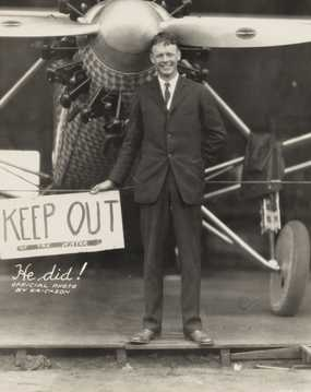 Black and white photograph of Charles Augustus Lindbergh with his plane, c.1927.