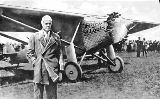 """Black and white photograph of Charles Augustus Lindbergh with the """"Spirit of St. Louis,"""" c.1927."""
