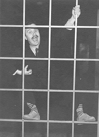 Black and white photograph of Clement Haupers clowning around, c.1931.