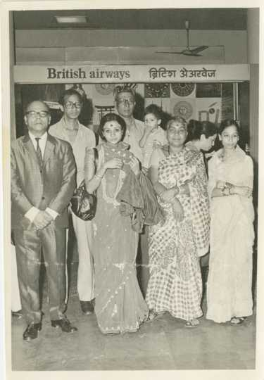 Black and white photograph of Preeti Mathur (first row, center left) at Bombay Airport in April 1978 with family on the eve of her departure to the United States. Used with the permission of Preeti Mathur.