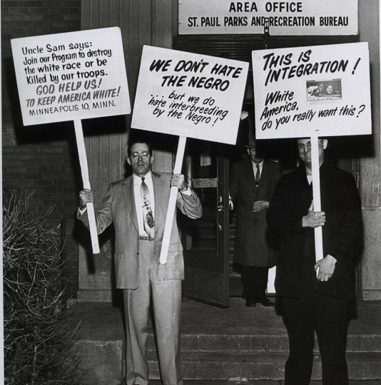 """Fair housing protesters from the """"Committee to End Discrimination against Fourth Class Whites,"""" December 19, 1962, St. Paul Pioneer Press. Minneapolis and St. Paul Newspaper Negatives Collection, Minnesota Historical Society."""