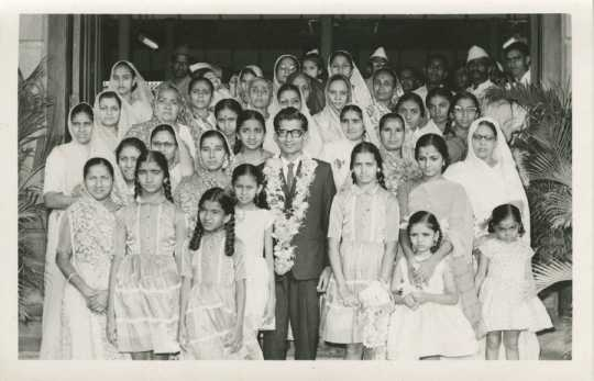 Black and white photograph of Ram Gada (center) prepares to leave India for Minnesota ca. 1960. Used with the permission of Ram Gada.