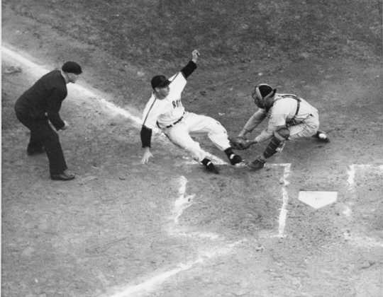 A Rox player slides home in an exciting play captured by St. Cloud Times photographer Myron Hall, c.1949. From the Myron Hall Collection, Stearns History Museum and Research Center, St. Cloud.