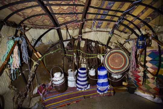 Photograph of the interior of a traditional Somali home, recreated for the Somali Museum of Minnesota