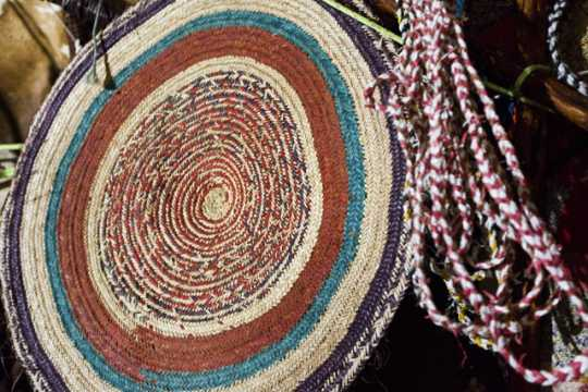 Photograph of kabad (kbæd or ka-bad; hand-woven mat/wall decoration)