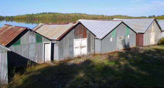 Color image of the Stuntz Bay boathouses on Lake Vermilion, Soudan Underground Mine State Park, 2011.