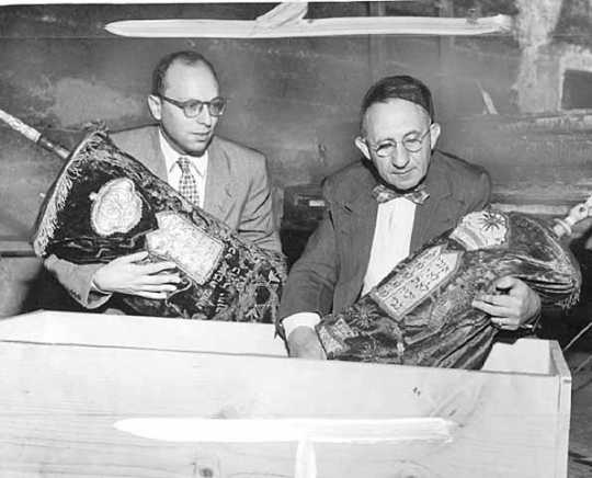 Rabbis Herman M. Cohen and Bernard S. Raskas prepare burned sacred articles for burial at the Temple of Aaron fire site, Ashland and Grotto, St. Paul.