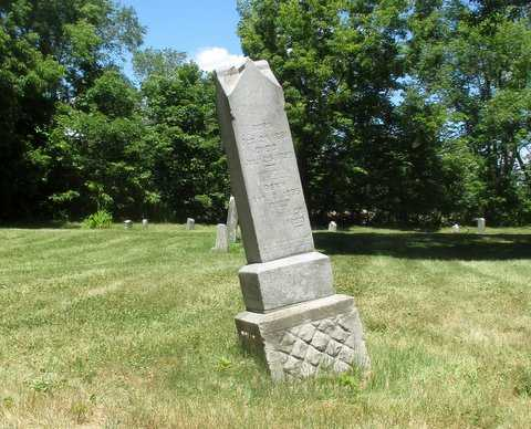 Color image of a tilted headstone in Pioneers and Soldiers Memorial Cemetery Cemetery in Minneapolis, 2016. Photographed by Paul Nelson.