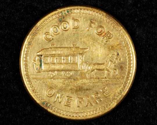 Color image of a Minneapolis Street Railway Company fare token (back), c.1905.