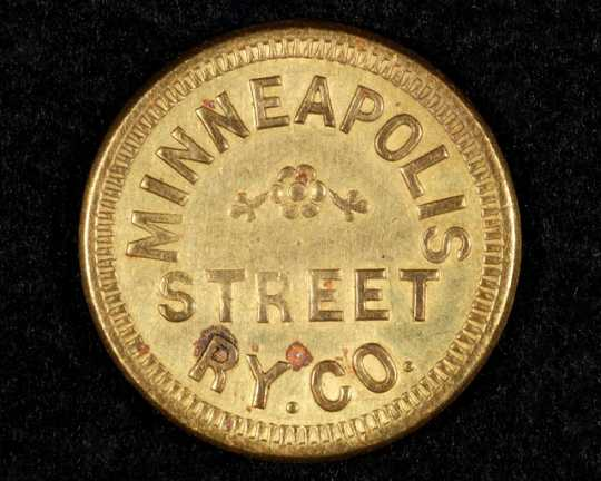 Color image of a Minneapolis Street Railway Company fare token (front), c.1905.