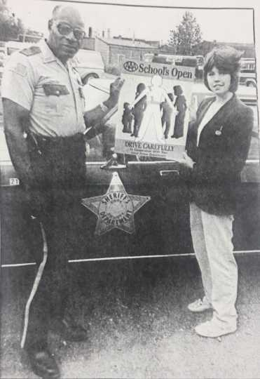 Photograph of John Lyght assisting with AAA teen safety program